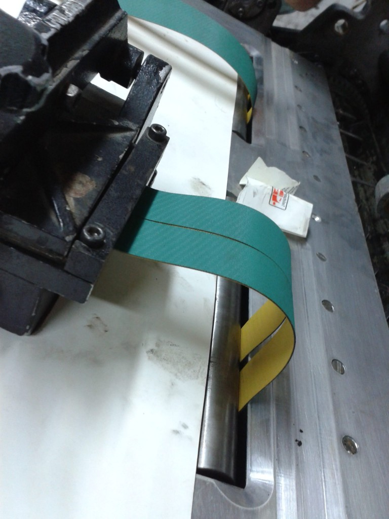 Reducing Printing Press Paper Board Cost with Table Belts